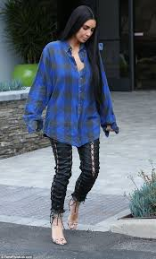kim kardashian steps out in strappy trousers and big shirt daily
