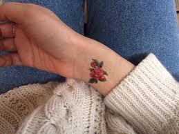 beautiful small realistic red rose tattoo on wrist