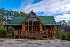 four bedroom pigeon forge smoky mountain tennessee group vacation pigeon forge four bedroom cabin rental with access to an arcade gaming system