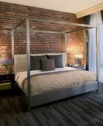 Metal Canopy Bed by Urban Bedroom Decor Metal Canopy Bed Against Red Brick Wall At