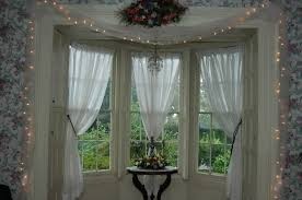 bay window decorations with classic textile curtain with ornament