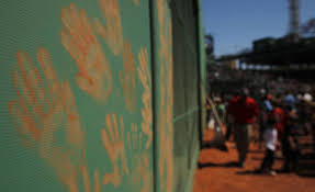 fenway reaches century mark the globe and mail fans leave their handprints on the outfield wall during an open house at fenway park in