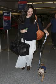 privacy policy madeleine fash madeleine stowe with her dog at lax airport in los angeles 05 31