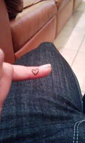 amazing small outline heart tattoo on finger