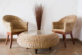 Sofa Table Against Wall Rattan Patio Furniture Against A White Wall Stock Photo Picture