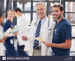 Doctor And Nurse Portrait Of Smiling Doctor And Nurse In Hospital Stock Photo