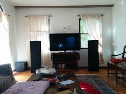 the evolution of my living room theater audioholics home ahh the vandersteens also included in the picture is lots of trash on the table and ugly ass couch covers we let our friends stay in the guest room for