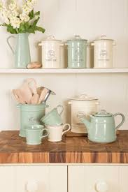 best 25 kitchen canisters ideas on pinterest open pantry flour vintage kitchen storage in rustic cream and rustic green image via beautifulkitchensblog co
