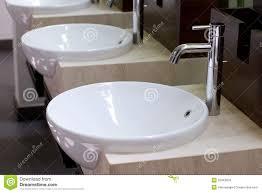 three of wash basins and faucets royalty free stock photos image