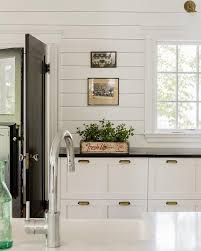 backsplash for black and white kitchen what we re loving now shiplap walls black countertops white