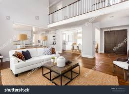 beautiful large living room hardwood floors stock photo 449761111 beautiful large living room with hardwood floors fireplace and couch in new luxury home