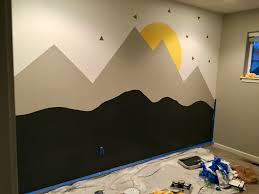 step by step mountain wall mural sincerely the smith s step 6 free hand the dark terrain at the bottom so for this part i actually just sketched this on with pencil ahead of time so i had a rough idea of