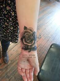 tattoo cover up on black skin a little cover up black and grey rose on a wrist esoteric tattoo