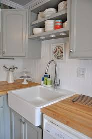 concrete countertops white beadboard kitchen cabinets lighting