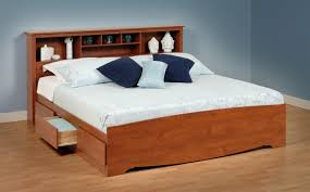 brown varnished pine wood low profile bed with bookcase headboard