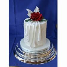 rosa drape wedding cake with icing drapes and roses