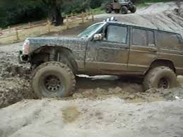 Jeep Cherokee Playing In Mud Below Truck Hill Youtube