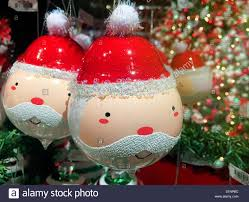 whimsical santa claus ornaments on display in macy s