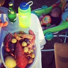 a delicious new england style backyard lobster clambake on a