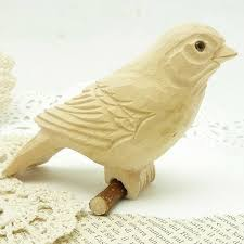 carved wooden bird 3 1 2 x 3 1 2 x 2 perches on wooden twig