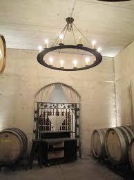 ideas wine garage design with round wine barrel chandelier and