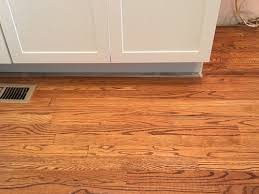 how to fix cabinet bottom new cabinets left gap on floor