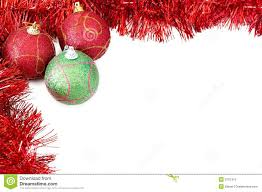 three christmas baubles with red tinsel royalty free stock images