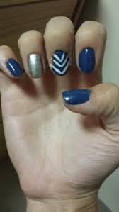 navy blue with ring finger silver nail and middle finger white