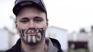 face tattoo holding new zealand man back from getting a job