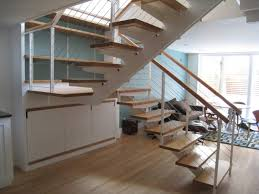 interior stair stringers with custom tread bracket and glulam