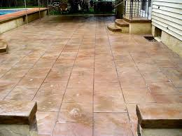 stamped and stained concrete patio that looks like terracotta tile