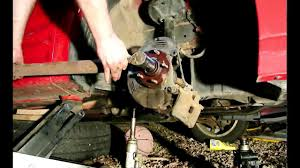how to change mistubishi eclipse wheel bearing front knuckle axle