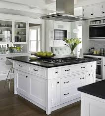 kitchen with black island and white cabinets 25 trendy contrasting countertops for your kitchen digsdigs