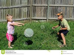 two kids playing ball in a backyard royalty free stock images