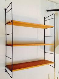 string shelving unit with black metal racks 1950s design market