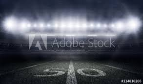 american football stadium in lights and flashes buy this stock