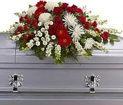 funeral casket and white tribute funeral casket spray in sunland ca