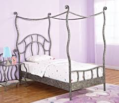bedroom pink colored metal twin canopy bed with dolls decorations