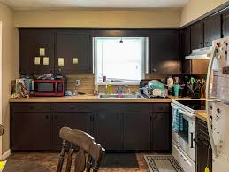 how to make cheap kitchen cabinets look better how to repaint kitchen cabinets painted by payne