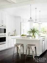 Dark Wood Floor Kitchen by White Kitchen With Dark Wood Floors And Industrial Counter Stools