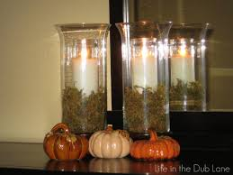 decorating hurricane vases with candle for enchanting dining nook