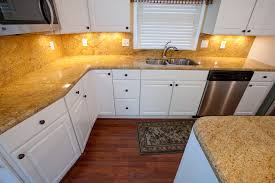 white kitchen cabinets with gold countertops madura gold and white cabinets traditional kitchen dc