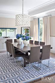 Modern Dining Room Lighting Fixtures In The Dining Room An Ironies Light Fixture Hangs Above The