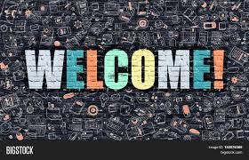 welcome multicolor concept on dark brick wall background with