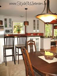 kitchen with boxcar red by benjamin moore paint on walls and white
