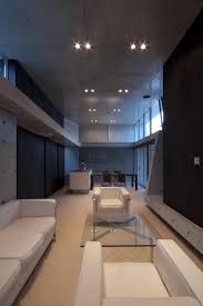 a minimalist house with a sleek concrete structure design milk