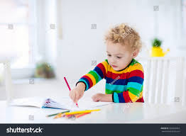 cute little boy doing homework reading stock photo 558435454