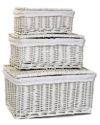 white wicker storage boxes with lids