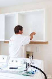how to attach cabinets to wall how to hang a wall cabinet the easy way a pinch of joy great