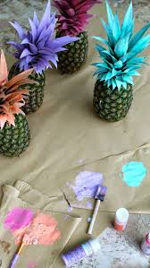 luau table centerpieces painted pineapples the cutest summer party decorations